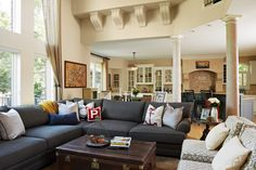 Christian and Samantha Ponder's living room has a cozy grey sofa filled with nautical themed pillows. Photo by Susan Gilmore