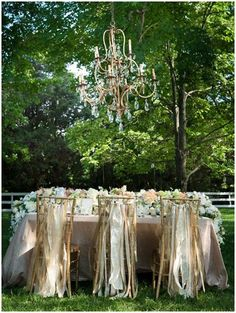 outdoor wedding in French chateau chic style with chandelier via www.frenchweddingstyle.com #wedding
