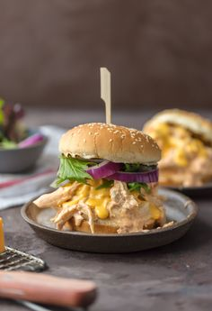 SLOW COOKER ROTEL DIP CHICKEN SANDWICHES are the ultimate way to tailgate for the Super Bowl! Spicy Cheesy Chicken Sandwiches made in the crockpot. SO MUCH FLAVOR! So addicting.