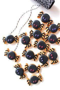 "Spider icing cookies ~ I LOVE this spider-cookie idea, using a ""wrapped candy"" cookie cutter!!!! They are SO CUTE!!!!"
