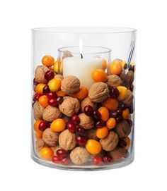 Cranberry, walnut and candle centerpiece