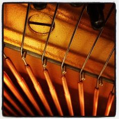 Piano strings / tuning pins. Photo by t7oufof on instagram.