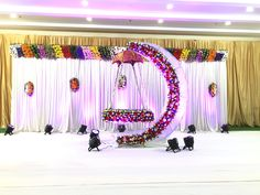 Amazing cradle ceremony decoration ideas for all your events. images for cradle decoration for naming ceremony from Quotemykaam catalogue. Naming Ceremony Decoration, Wedding Hall Decorations, Backdrop Decorations, Baby Shower Decorations, Flower Decorations, Birthday Decorations, Backdrops, Cradle Decoration, Indian Wedding Stage
