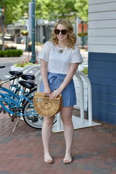 Casual Summer Outfit: Flutter sleeve top, chambray bow shorts, open toe flats and bamboo bag.