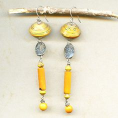 Yellow Submarine Earrings designed by Jamie Hogsett.  Made with our Paper to Pearl Beads, Tagua and Pewter Beads.  See more designs @Antelope Beads.com