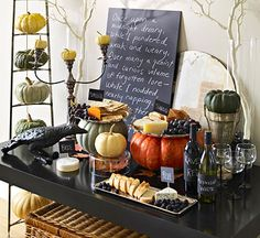 Pumpkin spread- plates of food on top of the pumpkins is a great idea to add height to the table!