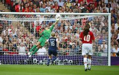 Goalkeeper Hope Solo of the U.S. saves a header by Japan's Yuki Ogimi in their women's soccer final gold medal match at Wembley Stadium ~Hope is amazing.