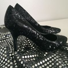 Ralph Lauren Sexy Black Sequin Pumps Lauren by Ralph Lauren 'Caia' Black Sequin Pumps. 3 inch heel. Perfect for holiday parties, New Year's Eve, or whenever you need to dress up for a date or night out! The shoes are in really good condition, but the soles are slightly scuffed (see photo) as I have worn the a few times. And there is one small nick in the trim along the top (last photo). Size 7.5. I don't have the box anymore, sorry! Ralph Lauren Shoes Heels