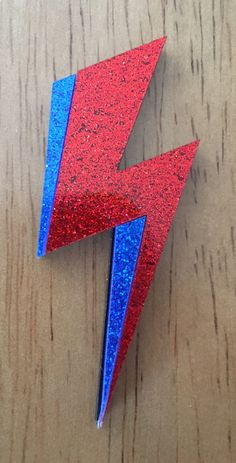 Ziggy played guitar, jamming good with Weird and Gilly, And The Spiders from Mars. He played it left hand, but made it too far, Became the special man, Then we were Ziggys Band Our tribute to the late David Bowie. Without whom modern music would much more boring. Brooch is 5.5cm high made of double layer acrylic