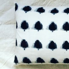 pillow by evalunda, woven in black and white.