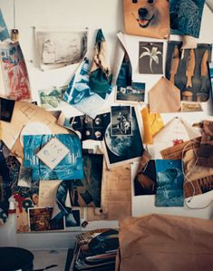 Photos, photos, photos! A photographer. I love the blues.  (Inspiration board/mood board/picture wall, artist studio/office.)