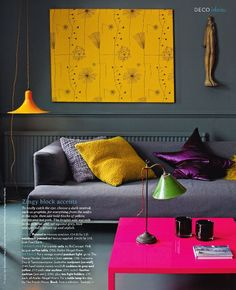 .Pops Of Color.  I like how the couch blends into the room and the table, art and pillows pop!