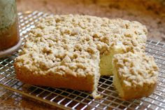 Preheat oven to 175�C/350�F/Gas 4. Grease and line a 900g/2lb loaf tin.  Combine all the crumble Ingredients in a bowl and rub in the butter with fingertips until mixture resembles breadcrumbs. Set aside.  Sieve the flour and bread soda into a bowl, stir in the candied peel and make a well in the centre.  Put the margarine in a saucepan over a low heat and melt. Remove from the heat and mix in the sugar, yogurt, eggs, lemon juice and vanilla essence.  Pour into the well and m...