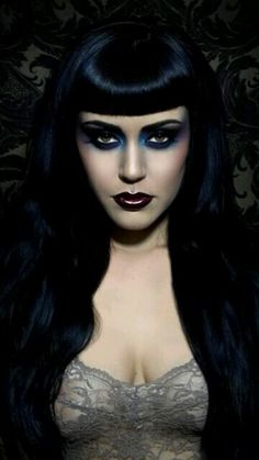 Gotische. Awesome make-up look! I love the hair too!