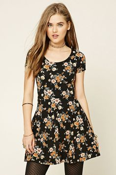 Style Deals - A knit skater dress featuring an allover floral print, a scoop neckline, and short sleeves.