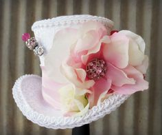 white top hat with feathers and flowers - Google Search