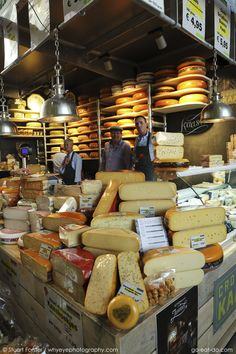 A cheese stall in the Markthal Rotterdam in Rotterdam, the Netherlands. The covered market was designed by architects MVRDV and the interior bears the biggest artwork in the Netherlands, 'The Horn of Plenty' by Arno Coenen and Iris Roskam. The market was officially opened by Queen Maxima on 1 October 2014. Photo by Stuart Forster.