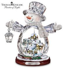 Thomas Kinkade Crystal Snowman Figurine Featuring Light-Up Village And Animated Train by The Bradford Editions