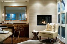 Whether clad with traditional elements or sleek and modern like this fireplace, the effect is warm and comforting.  #fireplace #candiceolson
