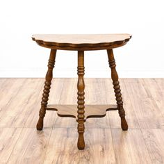 This antique side table is featured in a solid wood with a quarter sawn oak finish. This vintage end table has spindle legs, a second tier table top, and scalloped table edges. An adorable addition to any living room! #countryfarmhouse #tables #endtable #sandiegovintage #vintagefurniture