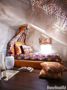 This loft bedroom is swathed in Brunschwig's Bombay wallpaper, custom-printed on Mylar. Bed and canopy by Maine Design. Vintage suzani bedcovering from Yurdan. Moravian star light, Visual Comfort.
