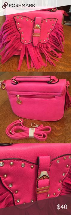 """Cross body bag hot pink butterfly fringe  Very cute cross body bag has flap closure, zip close w/2 inner pockets, one which zips. Gold hardware, outer butterfly w/ fringe. Carry handle on top if not using as a cross body  9x7x2"""" Bags Crossbody Bags"""