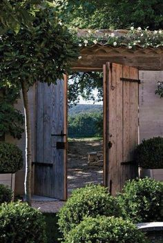 Garden gate ideas and garden inspiration: rustic planked garden gate doors to a beautiful lush garden with French Country style. garden inspiration rustic Hello Lovely - Inspiration for Interiors Garden Entrance, Garden Doors, Garden Gates, Garden Arbor, Entrance Doors, Small Gardens, Outdoor Gardens, Outdoor Spaces, Outdoor Living