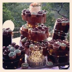 Rustic wedding cake and cupcakes. .