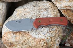 "TOPS XcEST-A-CT Alpha (Cross Country Emergency Support Tool), Coyote Tan Sheath. The old saying ""big surprises come in small packages"" definitely applies to this knife package. http://www.osograndeknives.com/catalog/fixed-blade-survival-knives/tops-xcest-a-ct-alpha-cross-country-emergency-support-tool-coyote-tan-sheath-6966.html"