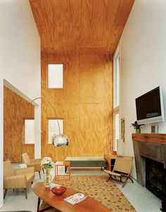 Plywood adds height to the room.