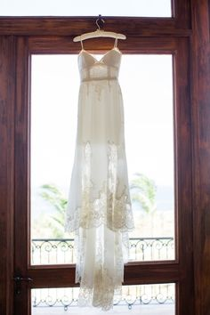 Lace trimmed wedding dress: http://www.stylemepretty.com/destination-weddings/2015/11/19/elegant-cabo-wedding/ | Photography: Sara Richardson - http://sararichardsonphoto.com/