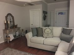 My living room is finally coming together. Thanks to Ashley Furniture Home Store. I'm loving my Wilcot Sectional.