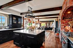 Eclectic Kitchen with Dutch door, Brick It New York Used Wall Thin Brick Veneer, Kitchen island, Ceramic Tile, Arched window