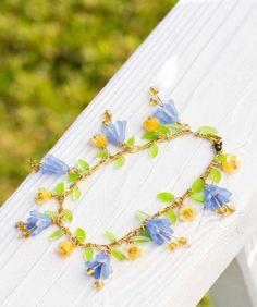 Delicate flower charm bracelet made with shrink plastic from book, Shrink! Shrank! Shrunk! by Kathy Sheldon.