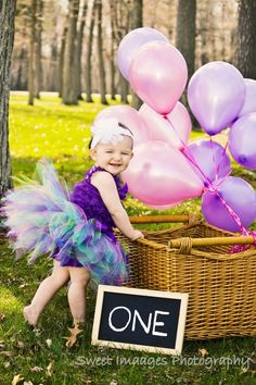 Little girls First birthday photo shoot idea. With chalkboard, Pink & purple balloons & an adorable tutu from etsy.com #firstbirthday #photoshoot