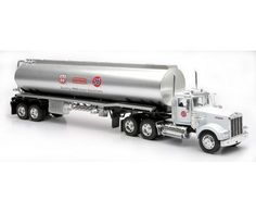 "NEW RAY Kenworth W900 76 Gasoline Tanker Truck 1:32 Diecast Trailer 76 Unical Singel by NEW RAY. $36.99. FOR AGE 8 AND UP.. 1:32 SCALE. MADE OF DIE CAST METAL AND PLASTIC PARTS. COMES IN RETAIL WINDOW BOX.. DIMENTION: 23"" L X 6"" W X 4"" H. Very detailed replica of Kewnorth W900 trailer made by New Ray, it looks like the real big rig. This collectible truck is made of diecast metal with plastic accessories. Has detailed headlights, signal lights, brake lights, an..."