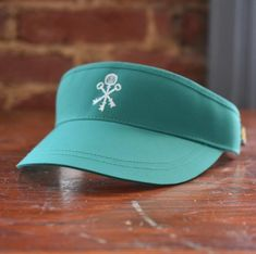 c0f1b7b268c88 This teal green visor features the Pappy   Company keys logo. Made for  golf