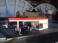 Kitbashed HO scale gas station from City Classic kit.