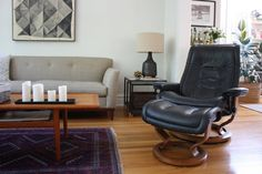Idea for a style compromise: He gets a leather chair, I get the neutral fabric sofa.