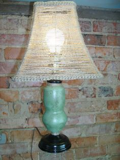 Small painted lamp with jute cord lampshade.
