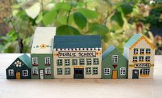 It would be cute to paint blocks that resemble all the houses you have lived in.