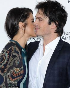 Phew: She avoided the temptation of going for the neck when she smooched Ian at the Independent Spirit Awards on Saturday