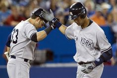 GAME 114: Sunday, Aug. 12, 2012 - New York Yankees' Derek Jeter, right, is congratulated by Nick Swisher after hitting a home run off Toronto Blue Jays pitcher J.A Happ during the sixth inning of a baseball game in Toronto. The Blue Jays won 10-7.