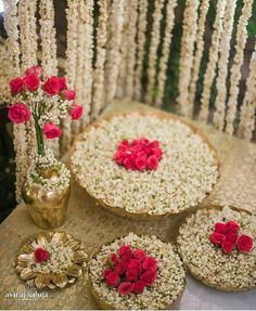 Love this floral Decor with prinstine white and red ....perfect for Mehendi