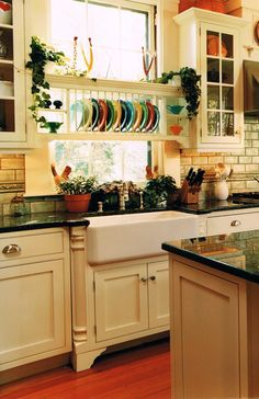 Farmhouse Sinks and plate holder Cool way to display my colorful fiesta ware! | Kitchen Ideas