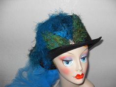 Black Top Hat with Turquoise Ostrich Floss and Train     $32.50