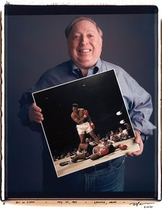 "Neil Leifer holding his iconic photograph of Ali vs. Liston from Tim Mantoani's project and book titled ""Behind Photographs"""