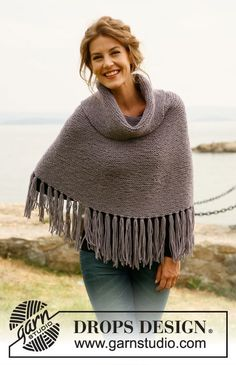 DROPS 134-16 - Knitted DROPS poncho with fringes and large collar and hat in garter st with pompom in Nepal. Size: S to XXXL