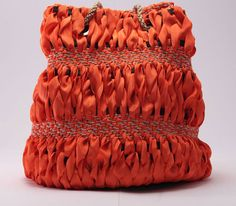 Naughty. Ladies bags in handwoven fabric. 95% poly 5% linen chain and linen handle. Godet orange.