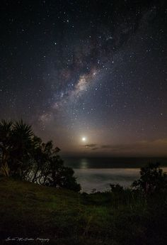 The Milky Way shining brightly in the sky above Venus and Mercury, Venus is casting a nice reflection in the water at Point Cartwright, Australia. By Damien McCudden.